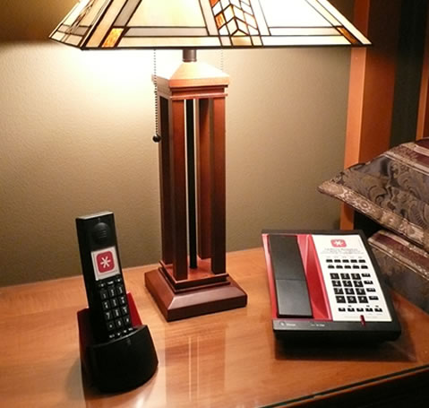 Hotel bedside table with Tel-Phone Resources phones